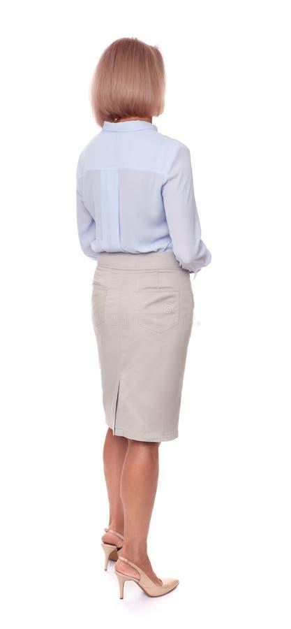 Hintere Ansicht der Mitte gealterten Geschäftsfrau lokalisiert lizenzfreie stockbilder