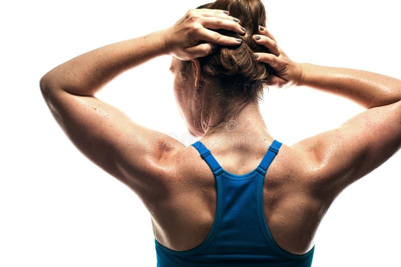 Hintere Ansicht der muskulösen Fraurückseite stockfotos