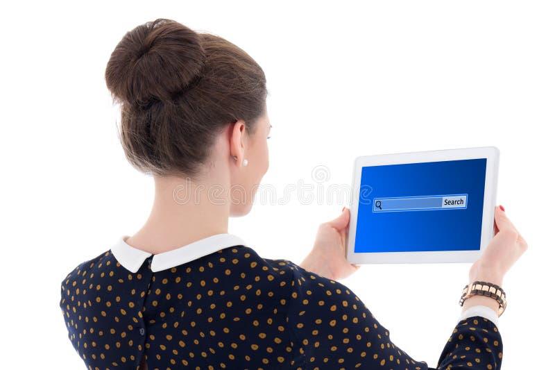 Hintere Ansicht der schönen Geschäftsfrau, die etwas in int sucht lizenzfreies stockfoto