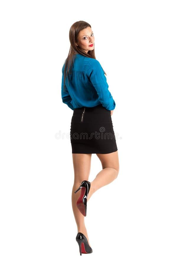 Hintere Ansicht der sinnlichen Geschäftsfrauaufstellung stockfotos