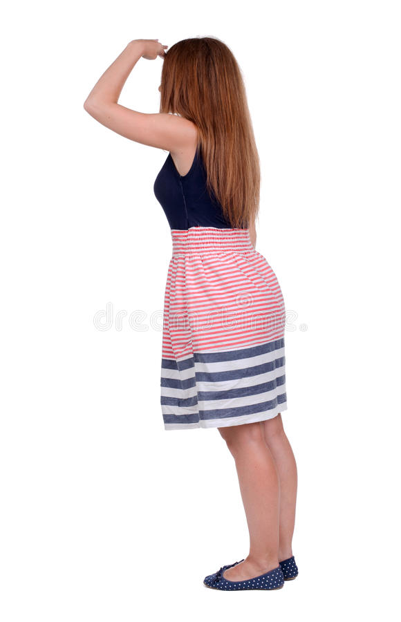 Hintere Ansicht der Stellung der jungen schönen Rothaarigefrau stockbilder