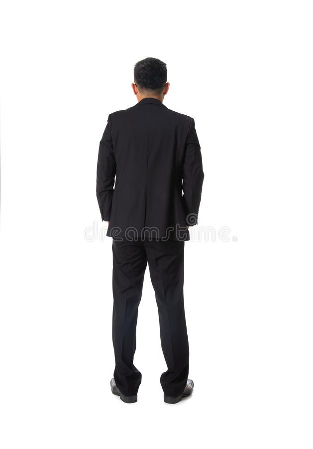 Hintere Ansicht des asiatischen jungen Geschäftsmannes lokalisiert über weißem backgr lizenzfreies stockfoto