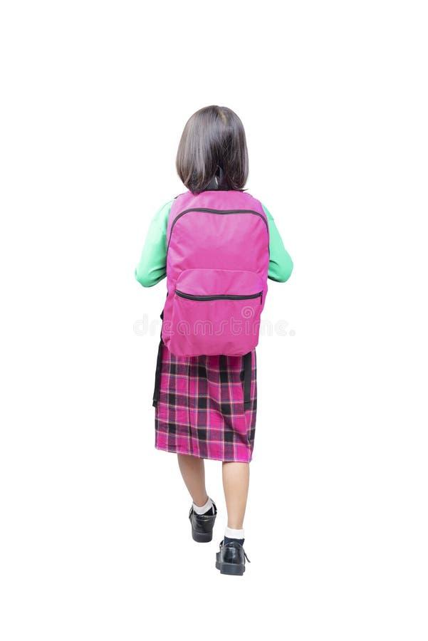 Hintere Ansicht des asiatischen netten Mädchens mit rosa Rucksackstellung stockbilder