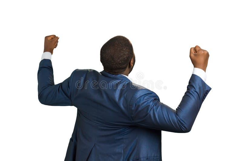 Hintere Ansicht des aufgeregten schwarzen Geschäftsmannes lizenzfreie stockfotos