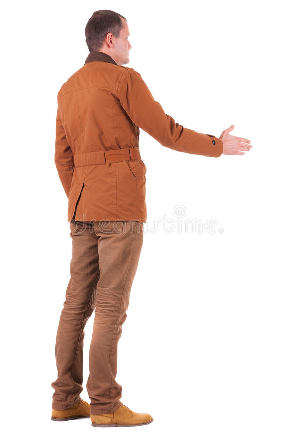 Hintere Ansicht des Geschäftsmannes in der Jacke heraus, zum von Händen zu rütteln. lizenzfreies stockfoto