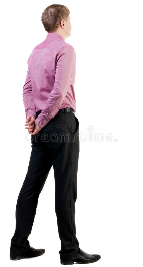 Hintere Ansicht des Geschäftsmannes im roten Hemd schaut nach vorn lizenzfreie stockbilder