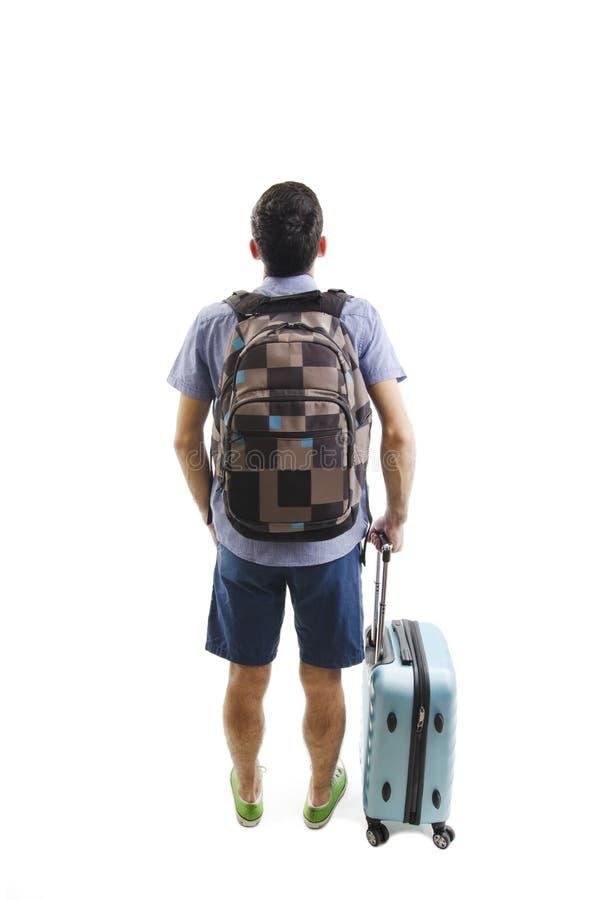 Hintere Ansicht des Mannes mit dem Rucksack und Koffer, die oben schauen Leutesammlung der hinteren Ansicht Rückseitenansicht der stockfoto