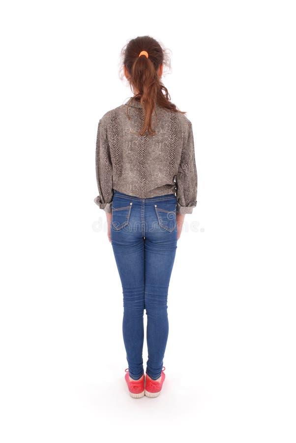 Hintere Ansicht des modernen jungen Mädchens, stehend Zurück gedreht ihr stockfoto