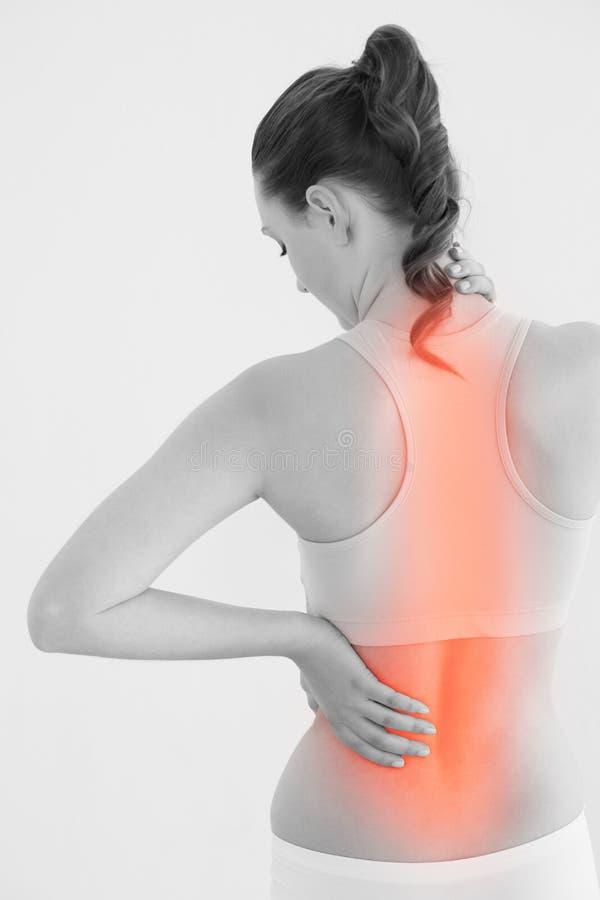 Hintere Ansicht des weiblichen Leidens von den Rückenschmerzen lizenzfreie stockbilder