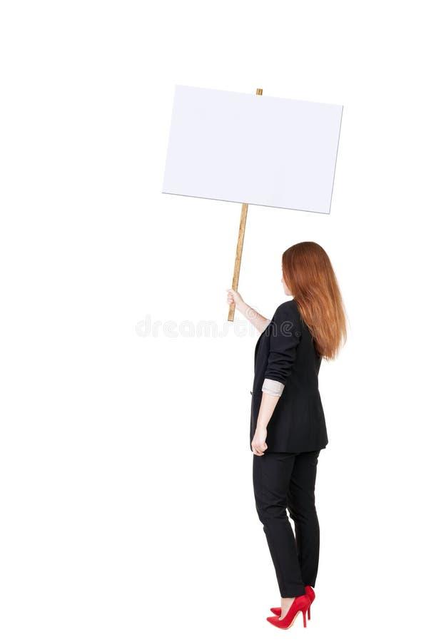 Hintere AnsichtGeschäftsfrau, die Zeichenbrett zeigt lizenzfreies stockbild