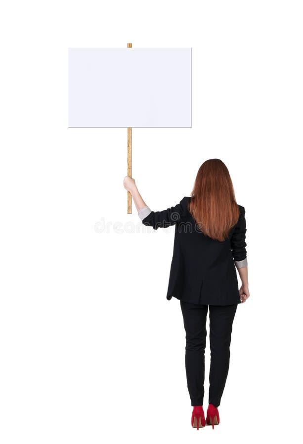 Hintere AnsichtGeschäftsfrau, die Zeichenbrett zeigt stockfotos
