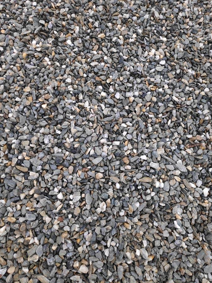 Hintergrund aus winzigen Steinen - graue und blaue Farbtöne lizenzfreie stockfotos