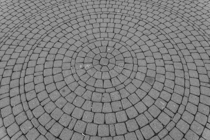 Hintergrund der alten Kopfsteinstraße in der Kreisform stockbild