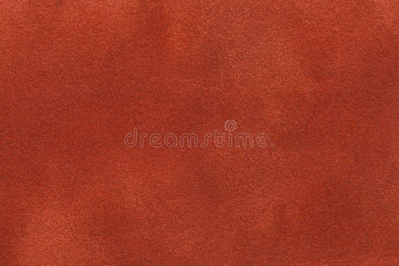 Hintergrund der dunkelorangefarbigen Veloursledergewebenahaufnahme Matte Beschaffenheit des Samts von Ingwer nubuck Gewebe stockbilder