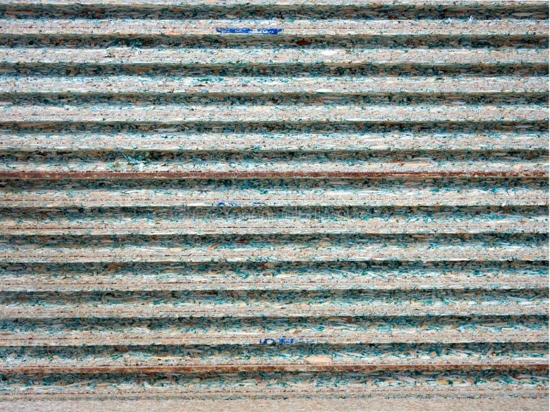 Hintergrund der Enden der lamellierten gerillten Spanplatte lizenzfreie stockfotos