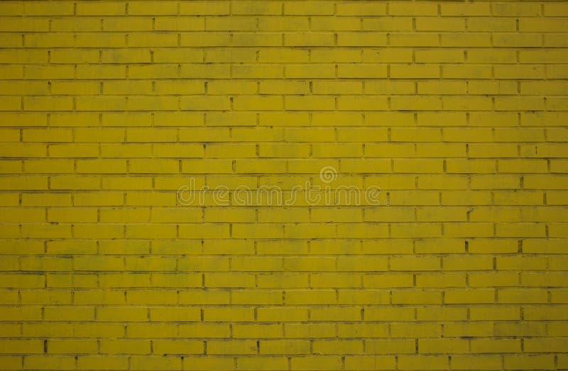 Hintergrund der gelben Backsteinmauer lizenzfreies stockbild