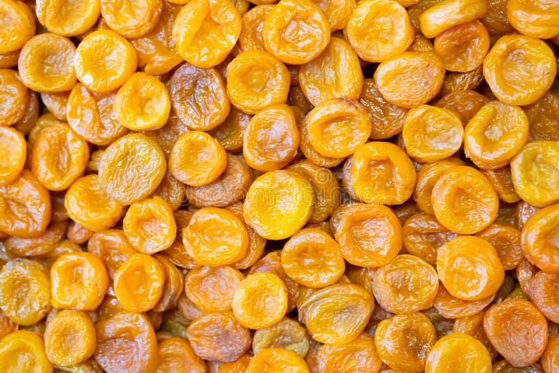 Hintergrund der getrockneten Aprikosen, Bewahrung der tropischen Früchte in den Märkten für Geschenk stockfotografie