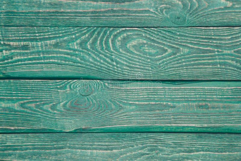 Hintergrund der hölzernen Beschaffenheit verschalt mit dem Rest der alten grünen Farbe horizontal lizenzfreie stockfotografie