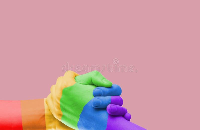 Hintergrund der Hand mit der gemalten Hand in LGTB stockbild