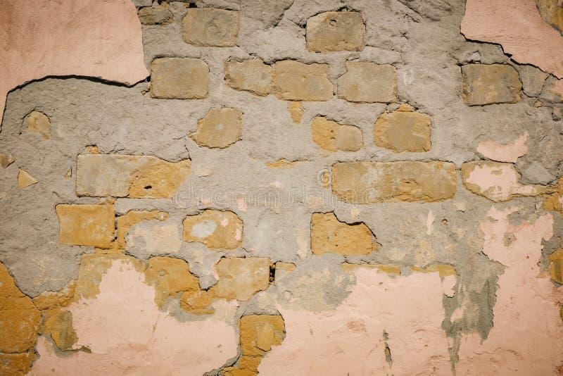 Hintergrund der Sprungsbacksteinmauerbeschaffenheit stockbild