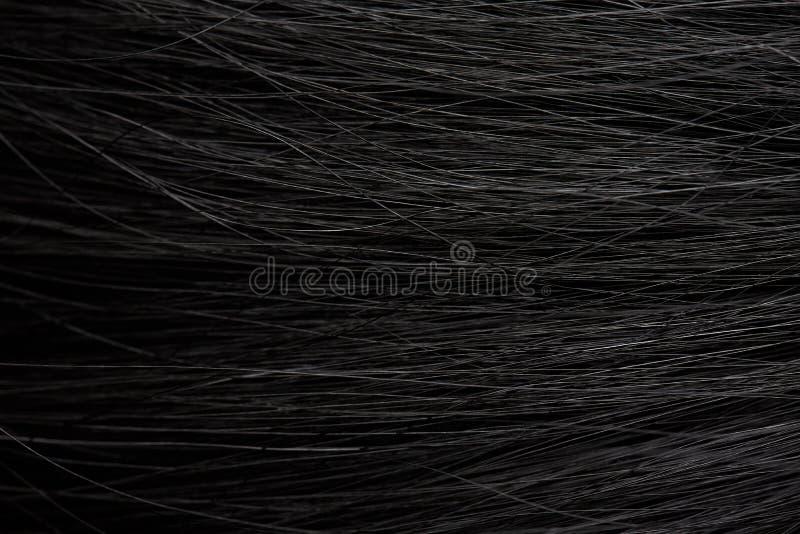 Hintergrund des dunklen Haares lizenzfreie stockfotografie