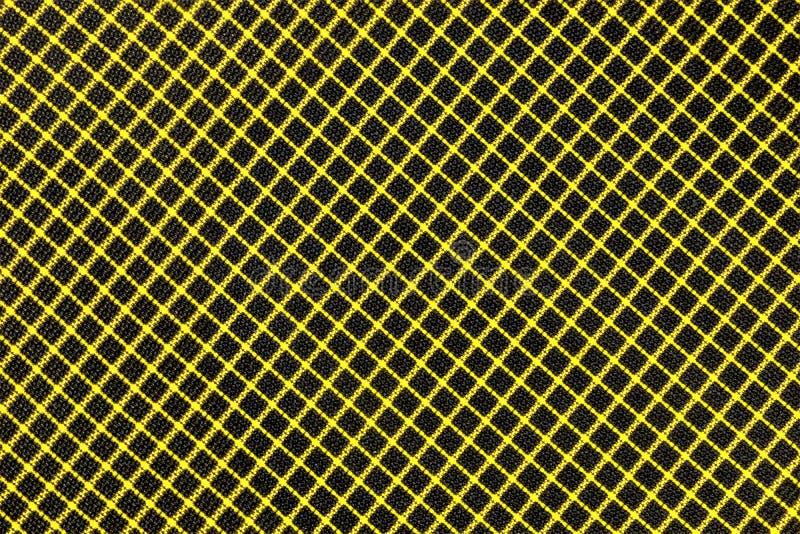 Hintergrund des Gewebes, gelbe Linien schneiden und bilden eine Zelle auf einem schwarzen Hintergrund, der für Feiertagsentwurf u stockbilder