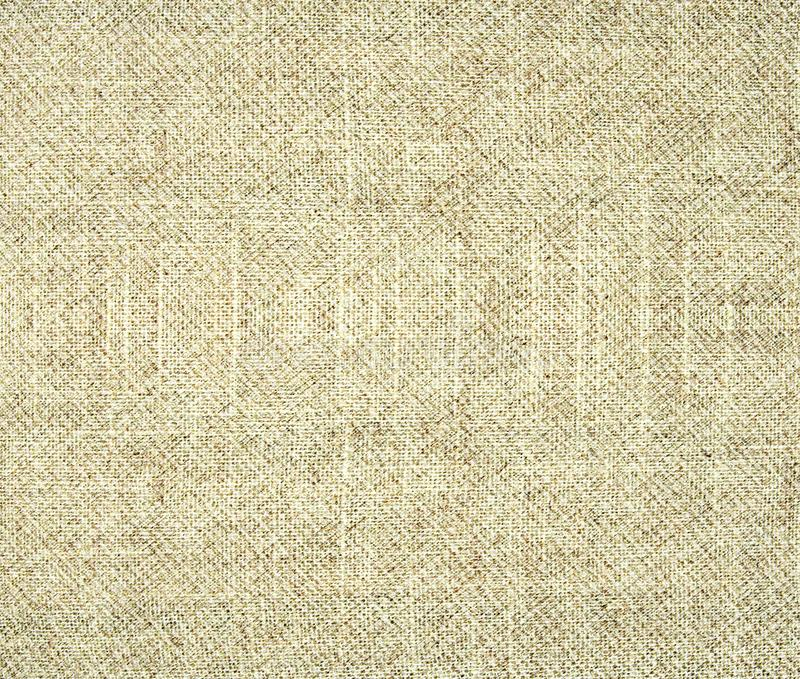 Hintergrund des hellgrauen und braunen woolen strukturierten Gewebes lizenzfreie stockbilder