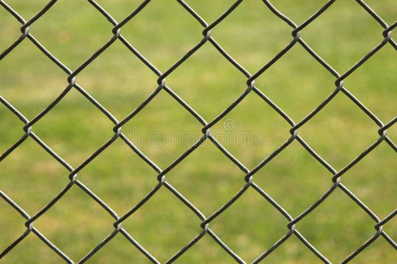 Hintergrund des Kettenlinkzauns lizenzfreies stockbild