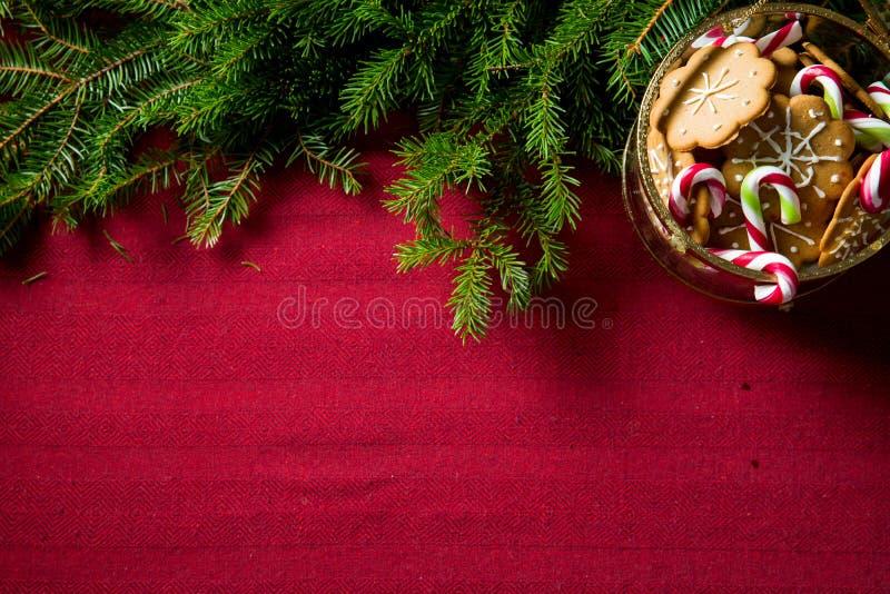Hintergrund des Lebkuchens und des Zuckerstangeglases lizenzfreies stockfoto
