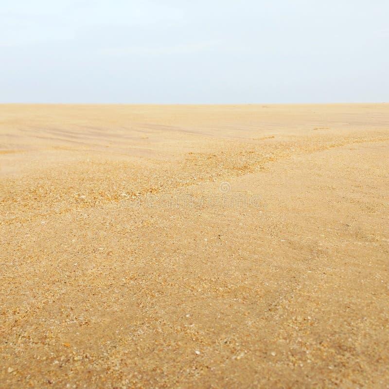 Hintergrund des Strandes sand lizenzfreie stockbilder