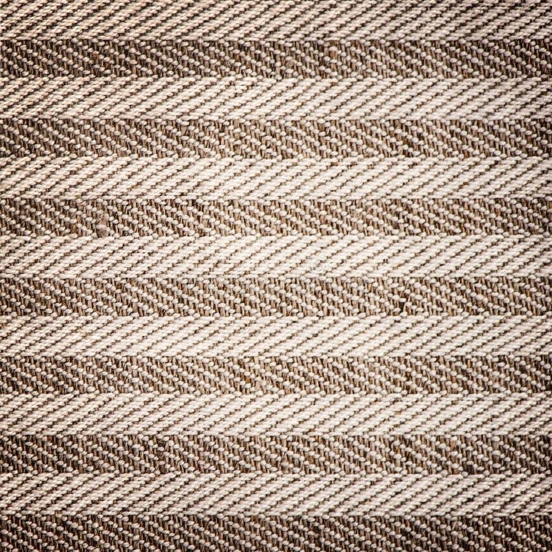 Hintergrund des strukturierten textil Braunweiß stockfotografie