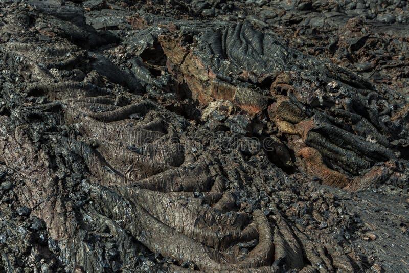 Hintergrund des Wellen gefrorenen Lavafeldes an Tolbachik-Vulkan, nach Eruption im Jahre 2012, Klyuchevskaya-Gruppe Vulkane lizenzfreie stockbilder