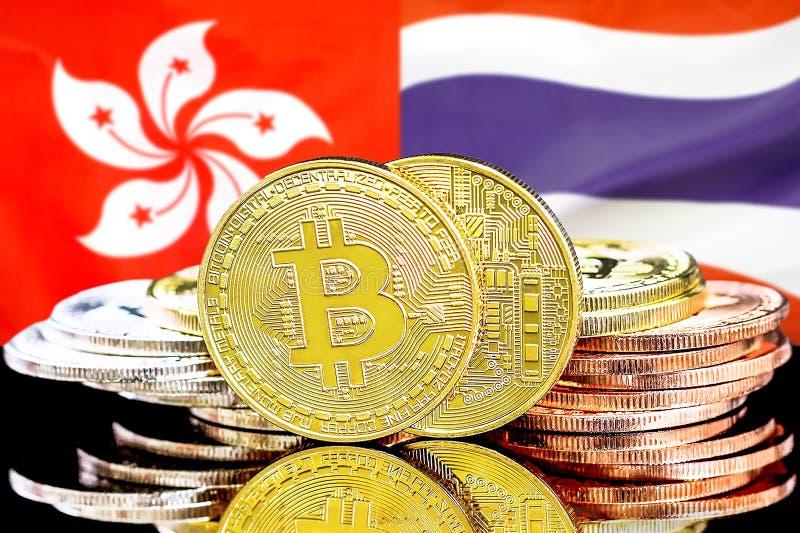 Hintergrund für Bitcoins auf der Flagge von Hongkong und Thailand lizenzfreie stockfotografie