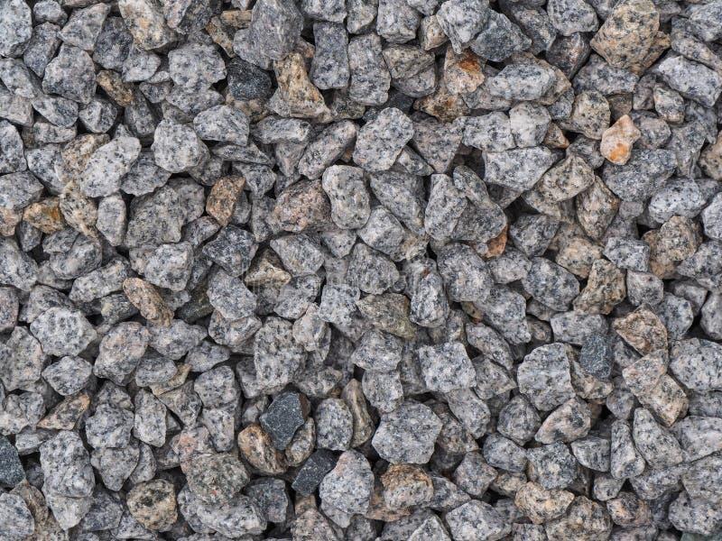 Hintergrund gemacht von einer Nahaufnahme eines Stapels des zerquetschten Steins stockfoto