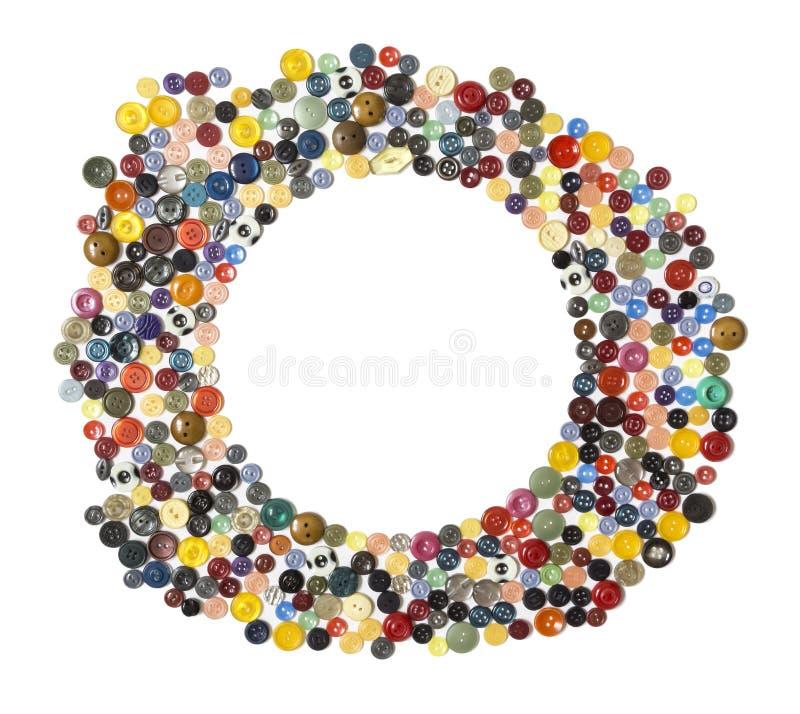 Hintergrund mit rundem Rahmen - mehrfarbige Knöpfe auf einer weißen Oberfläche stockbilder