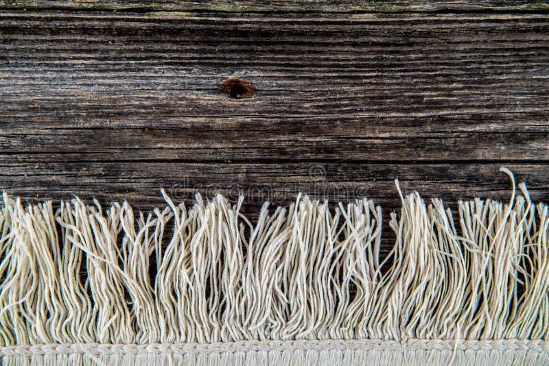 Hintergrund mit Teppichfranse stockfotografie