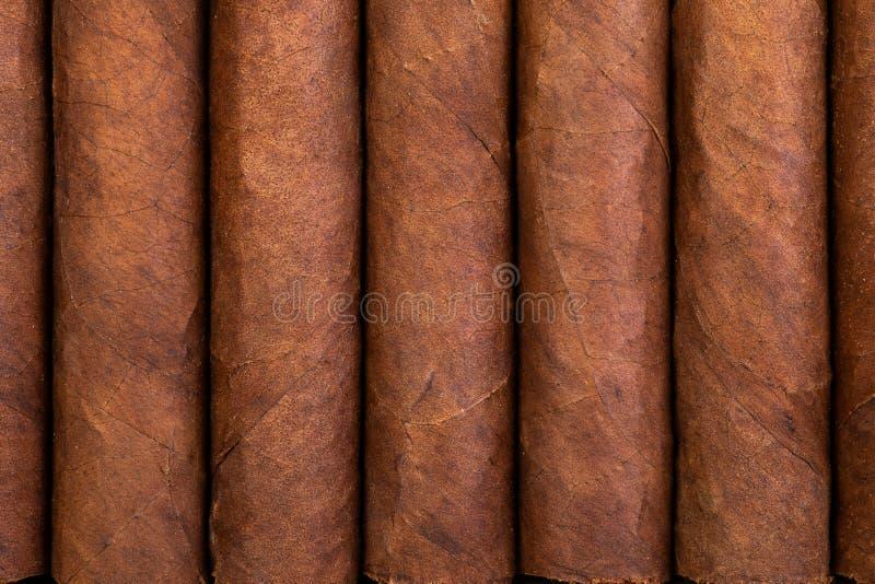 Hintergrund und Beschaffenheit von kubanischen Zigarren lizenzfreie stockfotos
