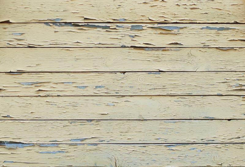 Hintergrund von altem gemalt in den gelben Brettern stockfotografie