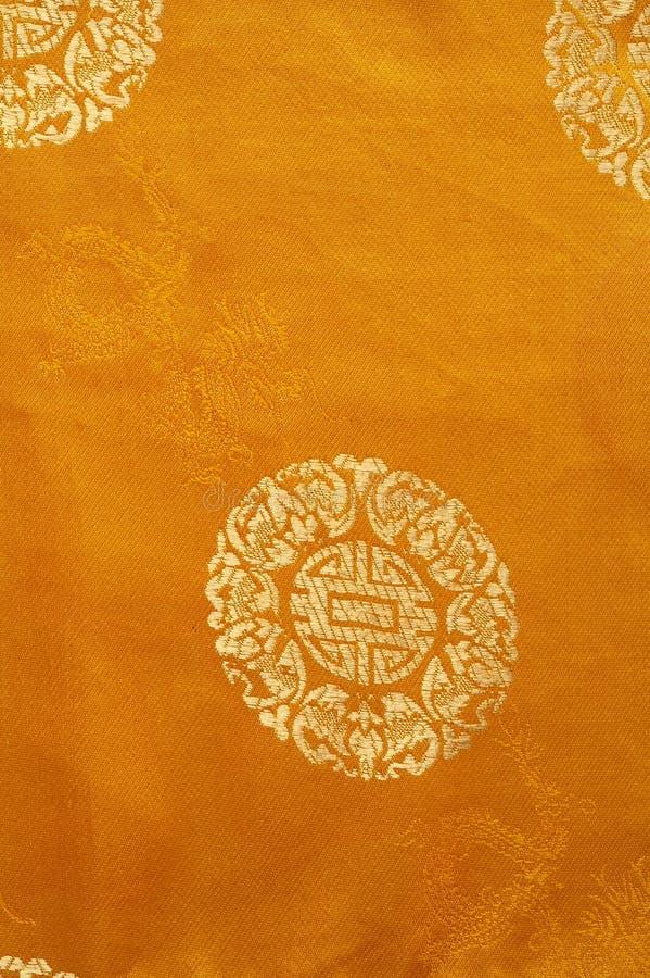 Hintergrund von einem Goldchinesegewebe lizenzfreies stockbild
