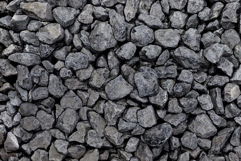 Hintergrund von einem runden dunklen Stein Dunkle Kieselkohlennahaufnahme faltete sich stockfotos