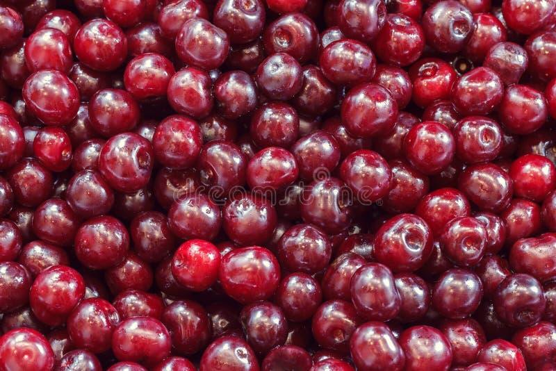 Hintergrund von einer roten Kirsche lizenzfreie stockfotografie