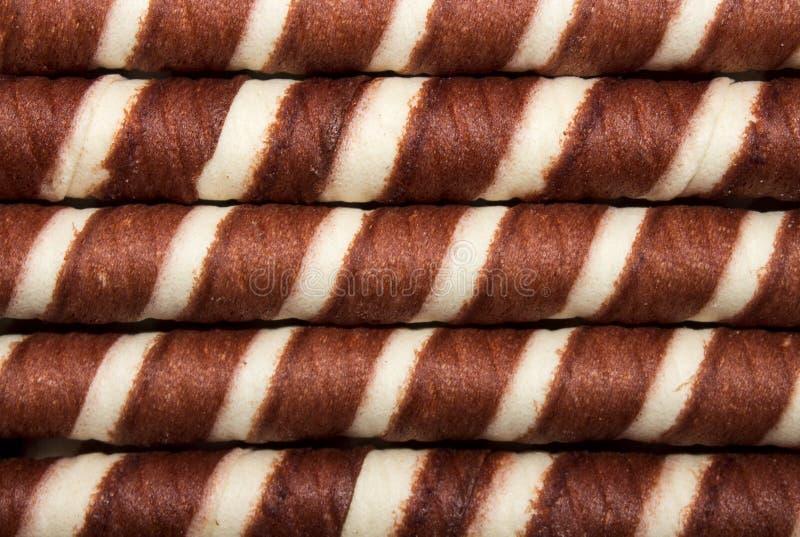 Hintergrund von Oblatenröhrchen mit der Schokolade stockfotografie