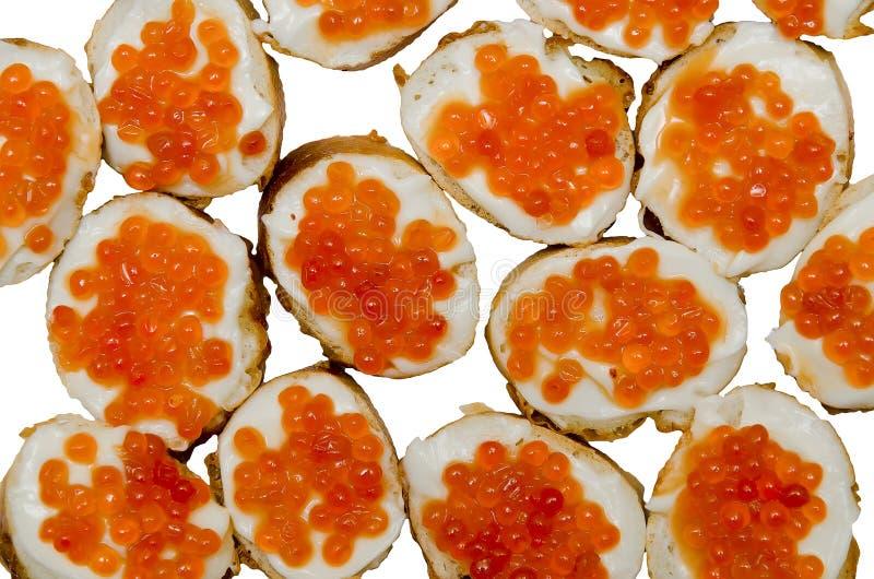 Hintergrund von Sandwiches mit rotem Kaviar stockfotos