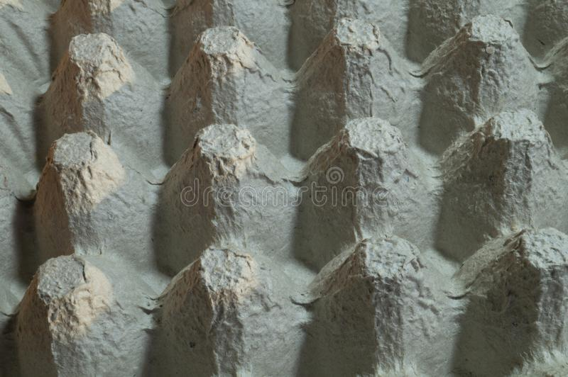 Hintergrundbeh?lter mit Zellen des gepressten Papiers f?r das Legen von Eiern lizenzfreies stockbild