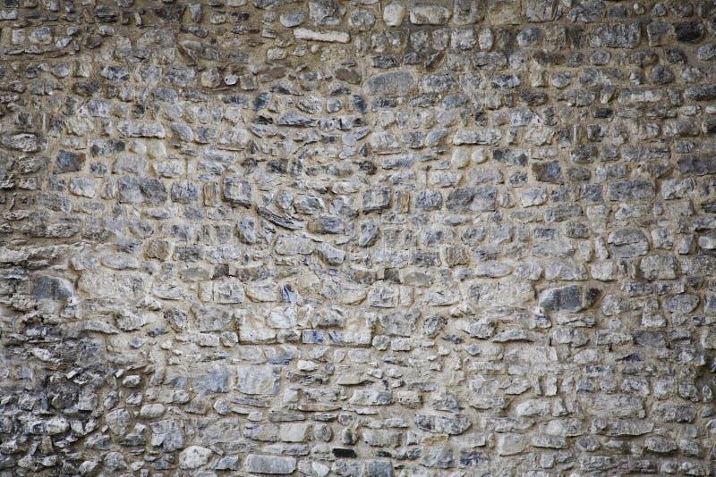 Hintergrundbeschaffenheit der Steinwand des mittelalterlichen Schlosses stockfotografie