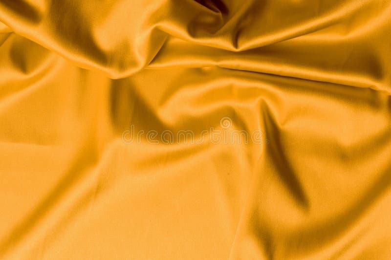 Hintergrundbeschaffenheitsmuster des dunklen gelben Seidengewebes Ein unriva stockbilder