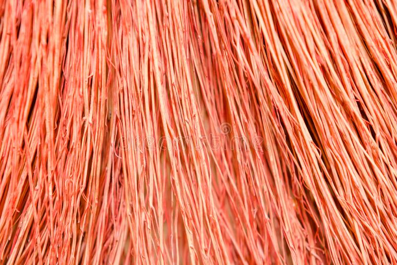 Hintergrundbesenabschluß oben Kehren Sie roten Besen der Beschaffenheit lizenzfreie stockfotos