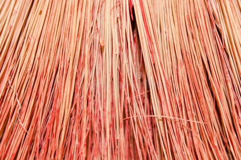 Hintergrundbesenabschluß oben Kehren Sie roten Besen der Beschaffenheit stockfoto
