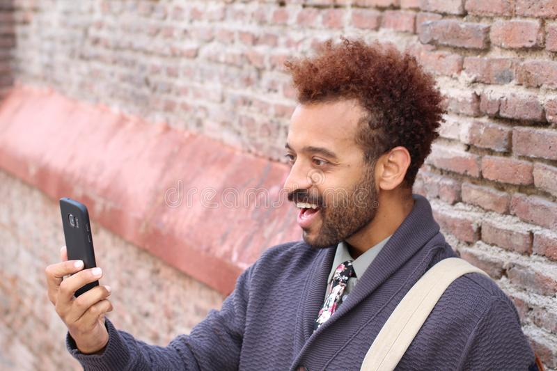 Hip afro entrepreneur taking a selfie royalty free stock photography
