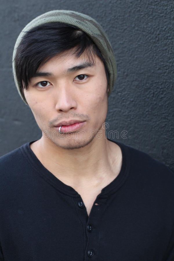Hip Asian man wearing a beanie stock images